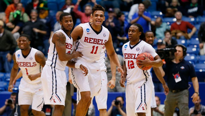 Mississippi forward Sebastian Saiz (11) reacts with teammates after defeating BYU in the first round of the 2015 NCAA Tournament on Tuesday night at UD Arena.