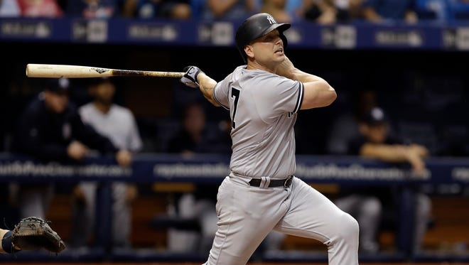 New York Yankees' Matt Holliday connects for a two-run home run off Tampa Bay Rays' Ryne Stanek during the eighth inning of a baseball game Friday, May 19, 2017, in St. Petersburg, Fla.