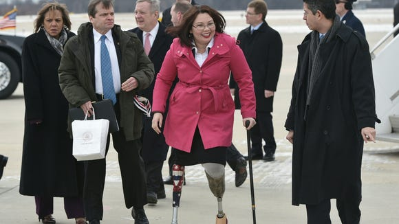 Rep. Tammy Duckworth C), D-IL, arrives in Springfield,