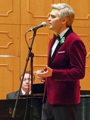 Alexandria native Slater Rhea sang Chinese folk songs Tuesday night at NSU, accompanied by NSU associate professor Michael Rorex