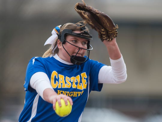 Castle's Meg Humphrey winds up her pitch during a softball tournament at Gibson Southern High School. The junior came on in relief to help the Knights win the regional championship.