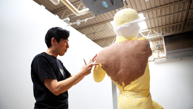 Artist Tom Tsuchiya works on a new sculpture of Reds baseball player Tony Perez at Essex Studios in Cincinnati Friday, May 22.