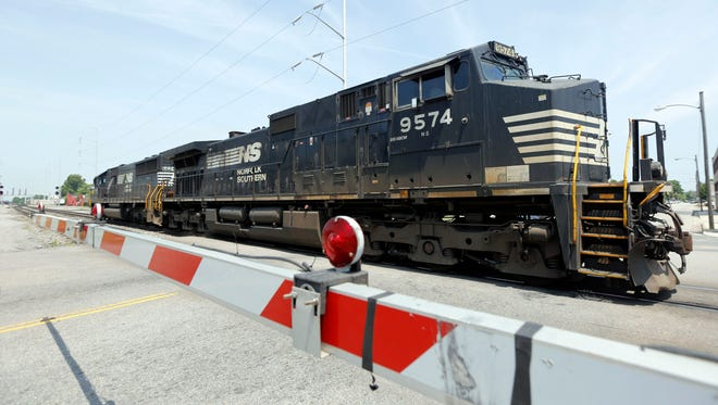 A Norfolk Southern locomotive moves along the tracks in Norfolk, Va.