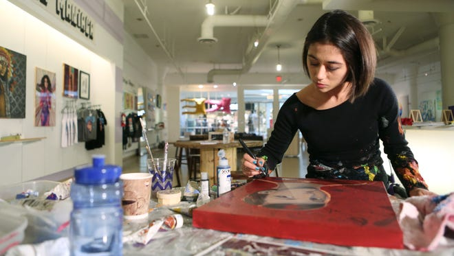 Artist Sofia Enriquez works on a portrait at MAKE in the Westfield Palm Desert on Tuesday, March 29, 2016 in Palm Desert, Calif.