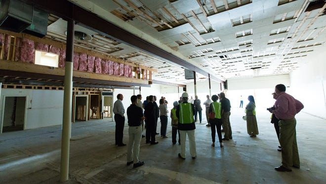 City officials tour the Camunez Building, part of downtown redevelopment tour. The city-owned building is expected to eventually house a restaurant and microbrewery.