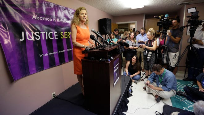 Rep. Donna Howard, D-Austin, speaks during a news conference at Choice Clinic, formerly Whole Woman's Health Clinic, Monda in Austin, Texas. A U.S. Supreme Court ruling Monday that struck down some Texas abortion regulations saying they are medically unnecessary, and that they unconstitutionally limit women's abortion rights.