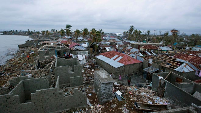 Homes lay in ruins after the passing of Hurricane Matthew in Les Cayes, Haiti, Thursday, Oct. 6, 2016.