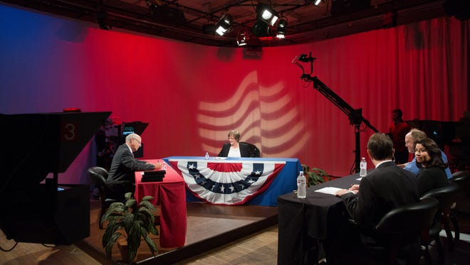 Congressman Steve Pearce, left, and Merrie Lee Soules,right, prepare to debate, that was hosted by KRWG TV's Fred Martino and the Las Cruces Sun-News' Sylvia Ulloa and Walt Rubel, Wednesday, October 26, 2016 at the KRWG Studios on the campus of New Mexico State University.