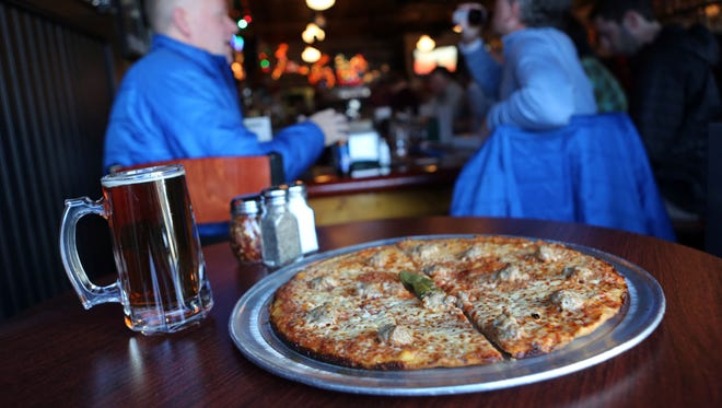 The sausage and hot oil pizza at Colony Grill in Stamford.