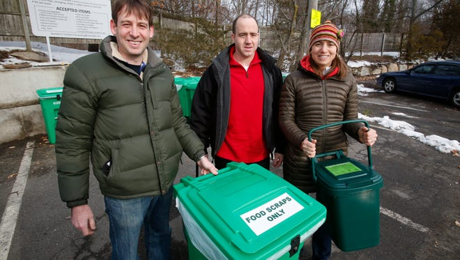 Members of the Scarsdale Food Scrap Recycling Committee, Ron Schulhof, Tyler Seifert, assistant to the superintendent of Scarsdale Department of Public Works, and Michelle Sterling, at the food scraps collection station at the sanitation department, Feb. 14, 2017.