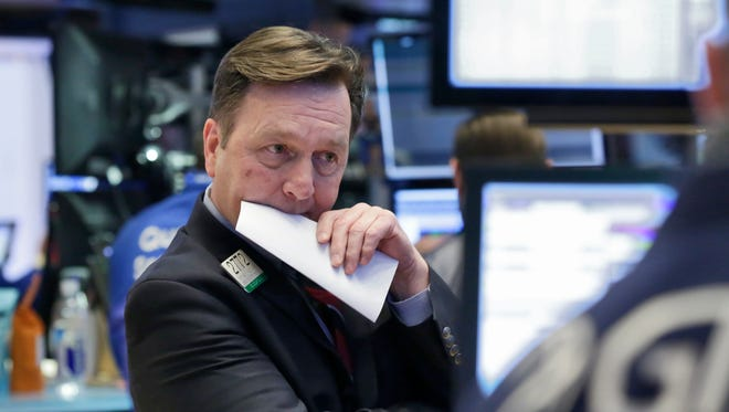 Specialist Thomas Facchine works on the floor of the New York Stock Exchange on Feb. 22.