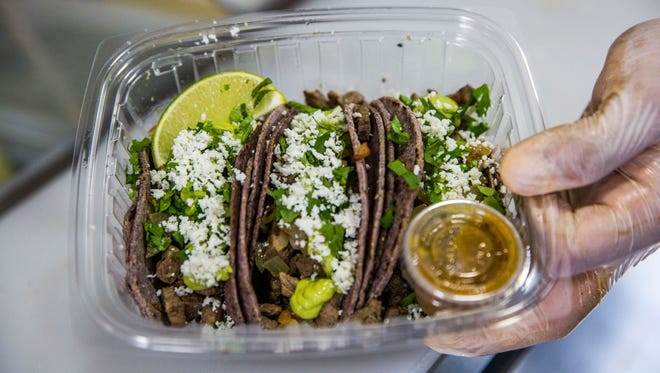Tacos wrapped in freshly made blue-corn tortillas from the new Taco Tummy food truck.