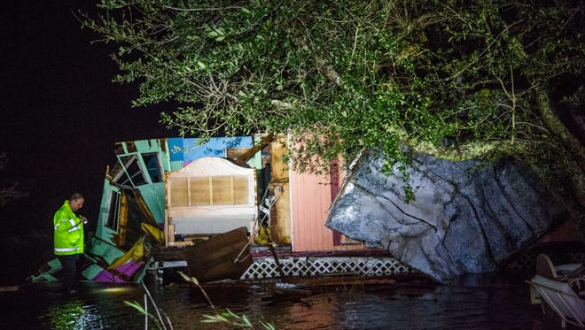 Battalion Chief Josh Bauer and Lt. Cody Rogers complete an initial assessment of the damage after Hurricane Irma came through Immokalee on Sunday Sept. 10, 2017.