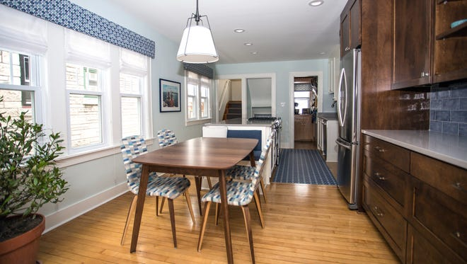 Megan Brakefield's clients in Bay View had a wall torn down to combine the old dining room and kitchen space into one area. This table serves as all the dining space the empty nesters need.