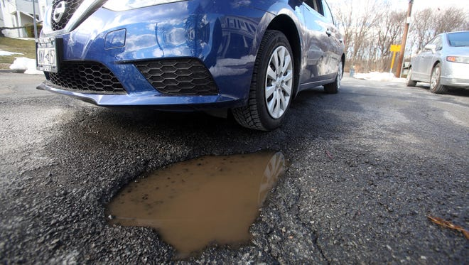 New Rochelle is suing a Brewster-based asphalt company that paved a few busy roads last year.