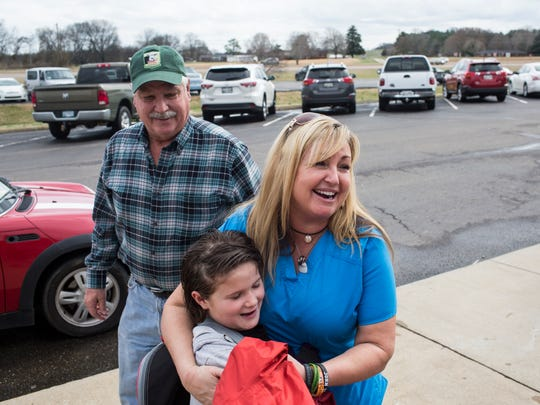 Heather Melton hugs her youngest child, Serena, 8, while picking her up from school Feb. 23, 2018. Melton lost her husband, Sonny Melton, during the 2017 mass shooting in Las Vegas.