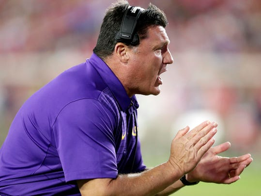 LSU head coach Ed Orgeron encourages his players in the first half of an NCAA college football game against Mississippi in Oxford, Miss., Saturday, Oct. 21, 2017. No. 24 LSU won 40-24. (AP Photo/Rogelio V. Solis)