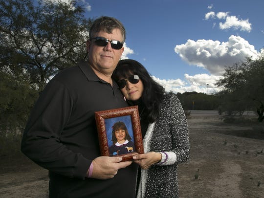 John and Roxanna Green hold a photograph of their daughter, Christina-Taylor Green, at the Canada del Oro Christina Taylor Green Memorial River Park in Tucson on Wednesday, Jan. 6, 2015. The park is named after their daughter, who was 9 when she was killed during the mass shooting in Tucson in 2011 that also wounded U.S. Congresswoman Gabrielle Giffords.