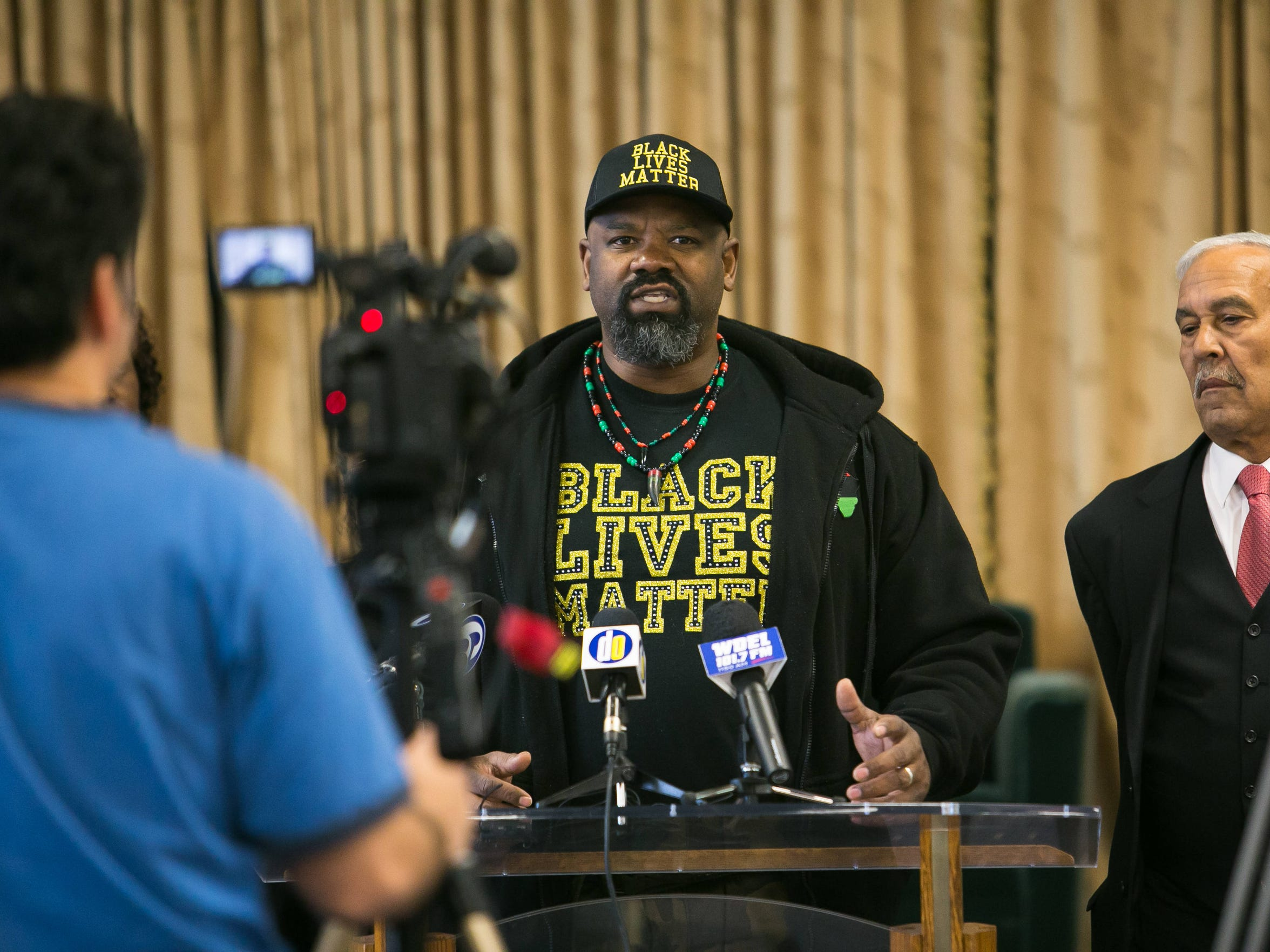 Mahkie Booker with Black Lives Matter speaks Wednesday morning at Tabernacle Full Gospel Baptist Cathedral to ask the U.S. Department of Justice to launch a criminal investigation into the shooting death of 28-year-old Jeremy McDole.