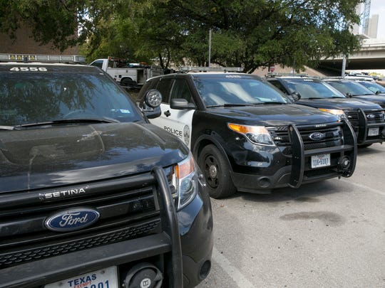 Ford police utility vehicles are parked outside police headquarters in Austin, Texas, on July 11, 2017. The Austin Police Department in July 2017 pulled nearly 400 Ford Explorer SUVs from its patrol fleet over worries about exhaust fumes inside the vehicles.