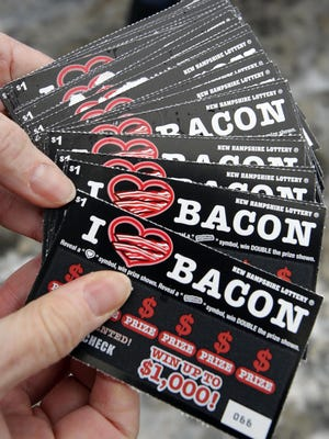 New scratch-and sniff lottery tickets are fanned out as part of a promotion Friday Jan. 30, 2015 at the welcome center in Hooksett, N.H.