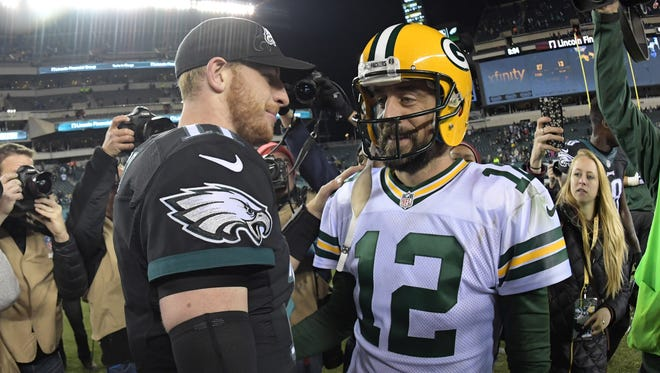 Philadelphia Eagles quarterback Carson Wentz, left, and Green Bay Packers quarterback Aaron Rodgers shake hands after a game Nov. 28, 2016.