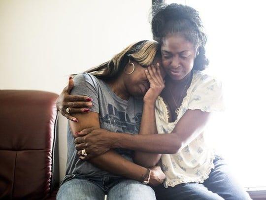 Joyce Stokes (right) holds her daughter, Porscha Pendleton,
