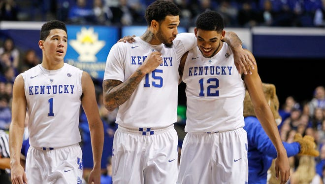 Kentucky's Willie Cauley-Stein, center, gives a little talk to Karl Anthony-Towns in the first half as Devin Booker looks on at the left. The Wildcats easily had a 70-55 win over Alabama Saturday night at Rupp Arena in Lexington. By Matt Stone, The Courier-Journal Jan. 31, 2015