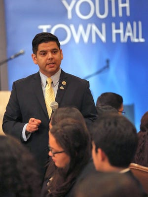 Rep. Raul Ruiz speaks to local high school students during a town hall event in 2016.