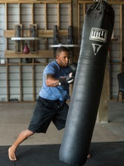 Aspiring professional Mixed Martial Arts fighter Pablo Marcal trains for his up coming pro debut. The rigorous training regime keeps the Pensacola resident in top physical shape.