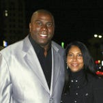 "Earvin ""Magic"" Johnson and wife Cookie Johnson walks on the red carpet during MGM's premiere of ""Be Cool"" at Grauman's Chinese Theatre on February 14, 2005 in Los Angeles, California."