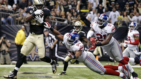 Saints tight end Benjamin Watson (82) pulls in a touchdown pass in in front of Giants free safety Landon Collins (21) and outside linebacker Devon Kennard (59) the second half of last season's game.