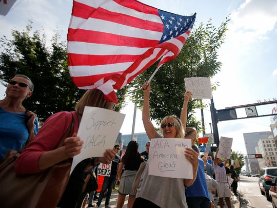 Immigration reform advocates, shown Sept. 5 in Cincinnati protesting the winding down of the Deferred Action for Childhood Arrivals (DACA) program, also are concerned about the federal government's use of detainment requests that they say violate immigrants' Fourth Amendment rights.