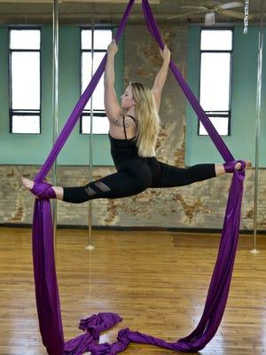Melissa Gandy, aerial instructor at Shore Pole, demonstrates aerial silks.  Long Branch, NJ