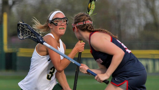 Sycamore's Brittany Murphy, left, is on the attack against Thomas Worthington.