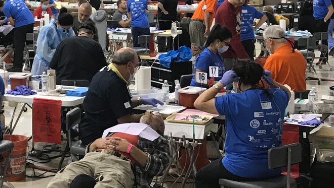 Doctors, patients and volunteers crowd the gymnasium at First United Methodist Church in San Angelo during the Texas Dental Association's Mission of Mercy event, Oct. 13-14.