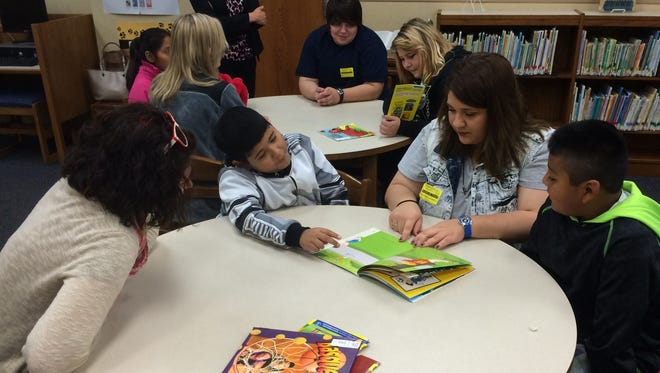 IU East students read to local elementary students as part of bilingual storytelling.