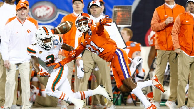 Clemson Tigers cornerback Ryan Carter (31) defends a pass intended for Miami Hurricanes wide receiver Mike Harley (3) in the third quarter in the ACC championship game at Bank of America Stadium.