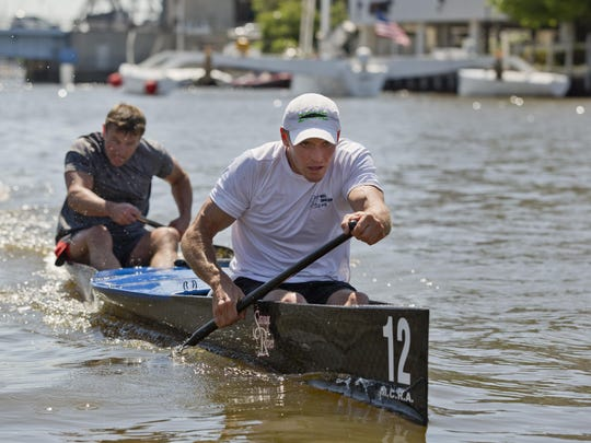 Nick Walton, of Eaton Rapids, and Tad Hill, of Livonia, race up the Black River during the 7th annual Back River Canoe race Saturday in Port Huron. The two finished first in the race.