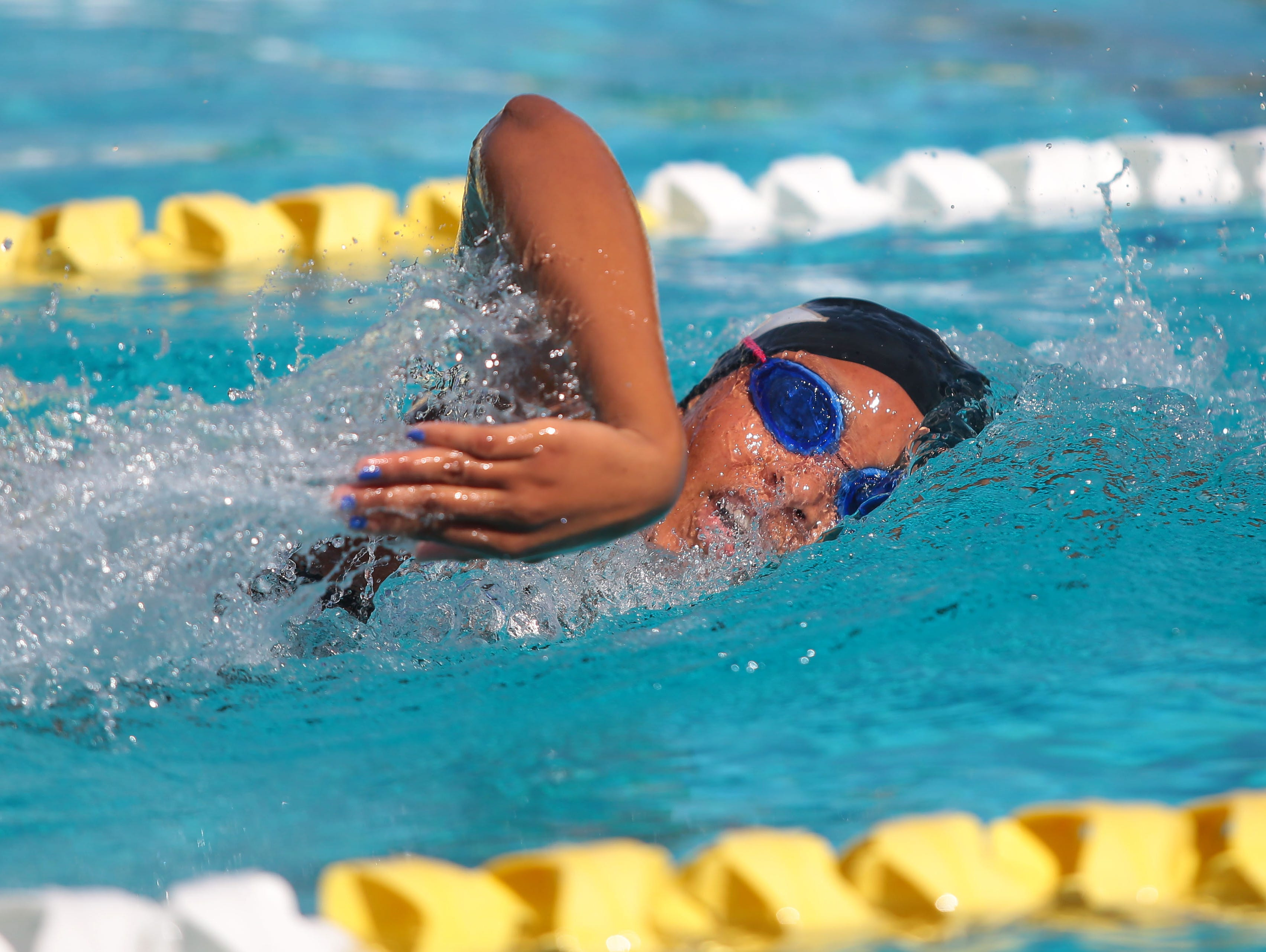 Xavier's Desiree Lewis swims the 200 freestyle as Palm Springs hosts Xavier in a high school swim meet on Monday, April 25, 2016, at the Palm Springs Swim Center.
