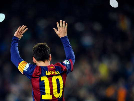 FC Barcelona's  Lionel Messi, from Argentina, gestures after scoring against Elche during a round of 16 first leg Copa del Rey soccer match at the Camp Nou stadium in Barcelona, Spain, Thursday, Jan. 8, 2015. (AP Photo/Manu Fernandez)