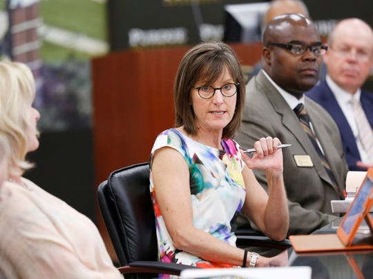 JoAnn Brouillette, one of three women on the Purdue University board of trustees, speaks during the board meeting Friday, July 18, 2014.