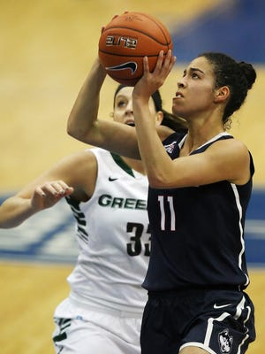 Connecticut's Kia Nurse, right, shoots against UW-Green Bay's Lexi Weitzer during Sunday's game in Estero, Fla.