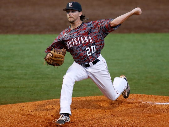 Louisiana-Lafayette pitcher Cody Boutte pitches in the first inning during an NCAA college baseball tournament regional game against Mississippi State in Lafayette, La., Sunday, June 1, 2014. (AP Photo/Jonathan Bachman)