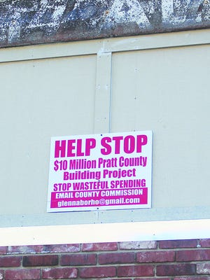 Those asking questions about the cost of a proposed public safety center in Pratt County have yet to get answers and signs continue to pop up around the Pratt community pointing out the project. A planned public safety meeting with question-and-answer session has been postponed indefinitely by county commissioners.