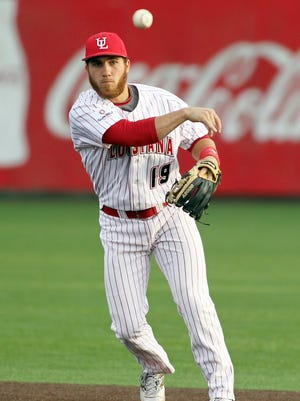 """UL second baseman Jace Conrad throws out a runner at first base in an NCAA baseball game against Nicholls State Tuesday at M.L. """"Tigue"""" Moore Field in Lafayette."""