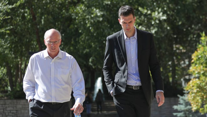 David Padgett walks from the Office of the President on the University of Louisville campus Friday afternoon with sports information director Kenny Klein.