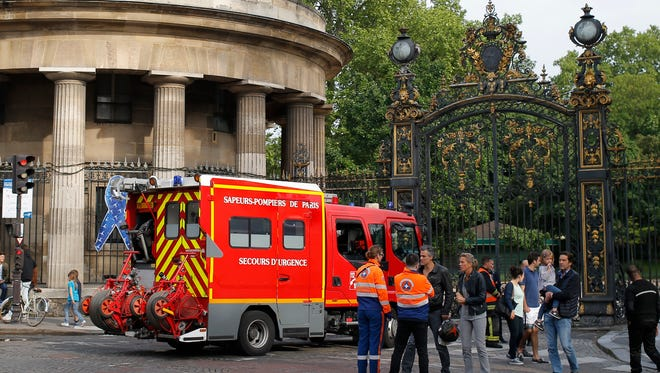 A fire truck is parked at the entrance to Monceau parc in the center of Paris, France, Saturday, May 28, 2016, after a lightning bolt crashed down onto a Paris park, striking 11 people at a child's birthday party.