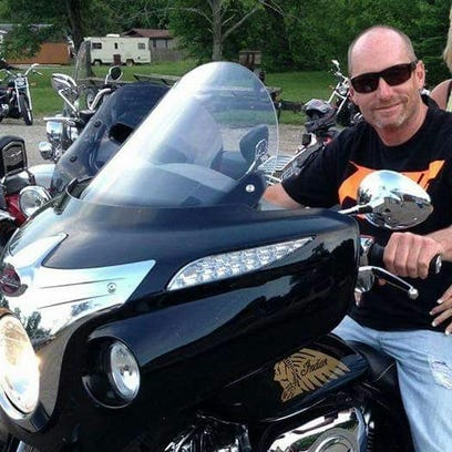 Rob Miracle sits on the Indian motorcyle he recently