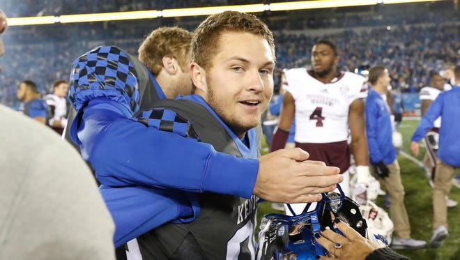 Oct 22, 2016; Lexington, KY, USA; Kentucky Wildcats kicker Austin MacGinnis (99) celebrates with teammates after kicking the game winning field goal against the Mississippi State Bulldogs in the second half at Commonwealth Stadium. Kentucky defeated Mississippi 40-38. Mandatory Credit: Mark Zerof-USA TODAY Sports